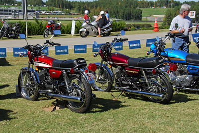 Ring-Ding  (on the left) in a vintage motorcycle show at Barber Motorsports.  That is a 1974 RD350 sitting to her right.  (The '74 was the only other RD350 on display)