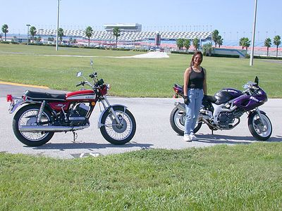 Ed's friend Sue at Daytona International Speedway next to her SV650S.  That's Ring-Ding on the left.