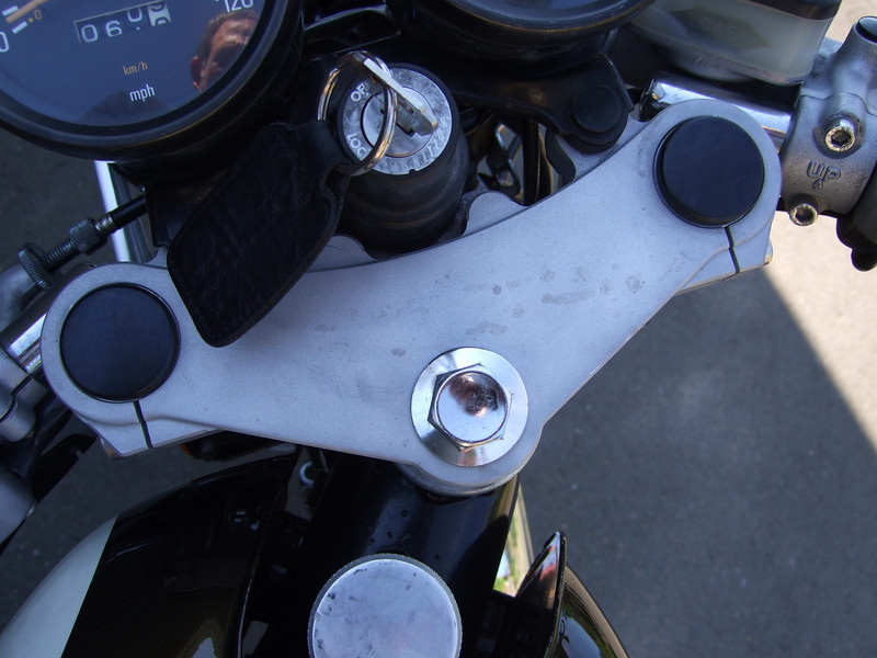 Alloy triple clamp. You can also see part of the billet oil tank cap.