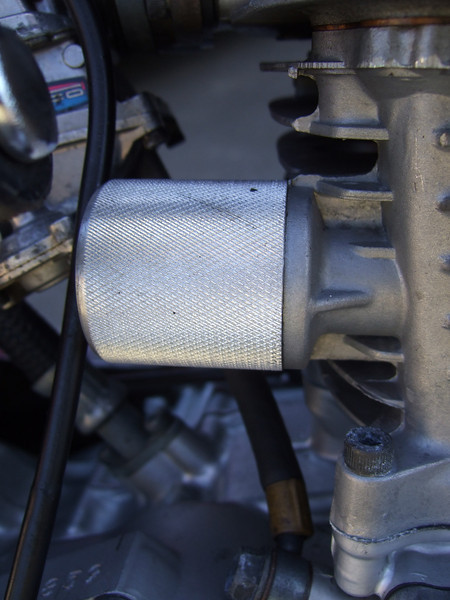 Aaron Collier billet cam chain tensioner cover. One of two or three made.