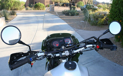 Renthal handlebar, Acerbis guards, spare clutch cable.