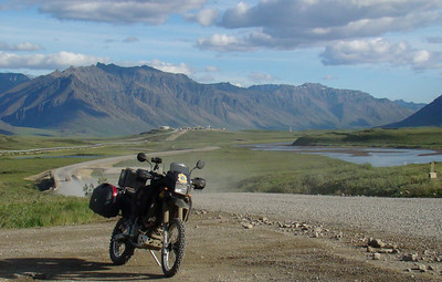 7/4/08 8:11PM - The Atigun valley, with Pump Station 4 appearing to be guarding the entrance, is the backdrop for the KLR in this photo.
