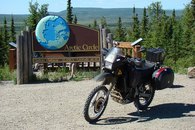 7/4/08 2:00PM - On its first trip up the Dalton Hwy to Deadhorse, the KLR gets its portrait taken in front of the Arctic Circle sign.