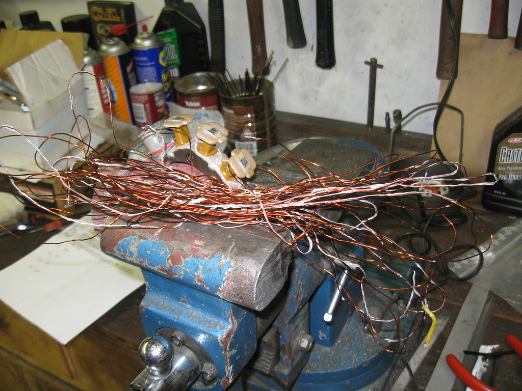Stock lighting coil off.  Was 20g wire I think, and there were about 74 turns on each of the 4 poles.