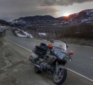 April 15, 2012  8:47 PM:  Returning to Glennallen from Palmer after a first-of-the-season ride with the setting sun dropping behind the nearby Talkeetna Mts around Mile 97 on the Glenn Hwy.