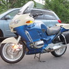 This shows  front crash bars re-installed, and saddle bags with the origninal  flat lids painted black with plastic coat.
