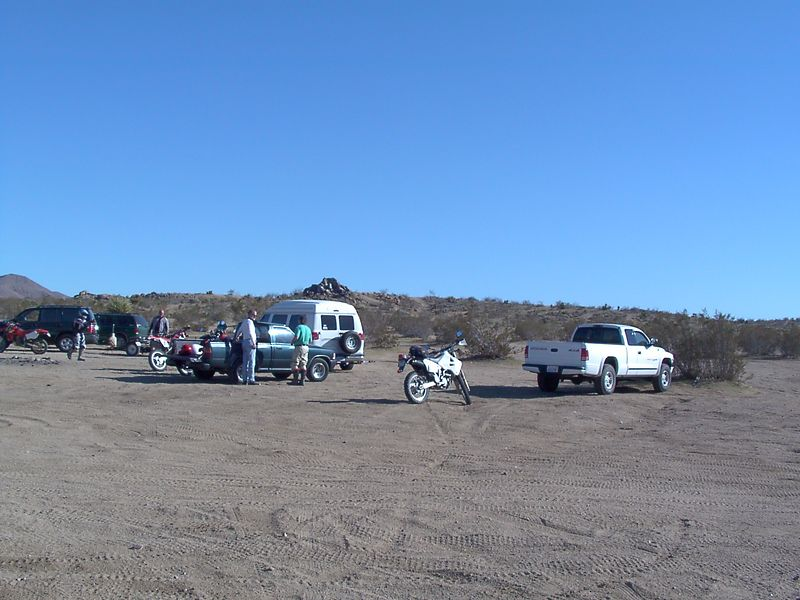 Another shot of the end of the day camp. <br /> <br /> MrMike's truck and bike in the foreground, then Pauls truck, then Mike's Van Nicks Toyota, and Crash's Truck in the background. Back over there someplace is BigDave's SUV...<br /> <br /> Yeah, that sky looks like rain. The weatherman was way off the mark. The weather was perfect. We could not have designed it better.