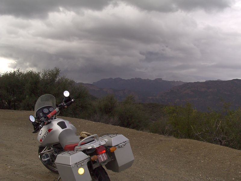 Above Malibu, look at that cloud! In just a few more corners the sun pops out and the folks who live in Malibu don't have to endure rain. <br /> <br /> It never rained enough all day to even wash the dust off my boots!