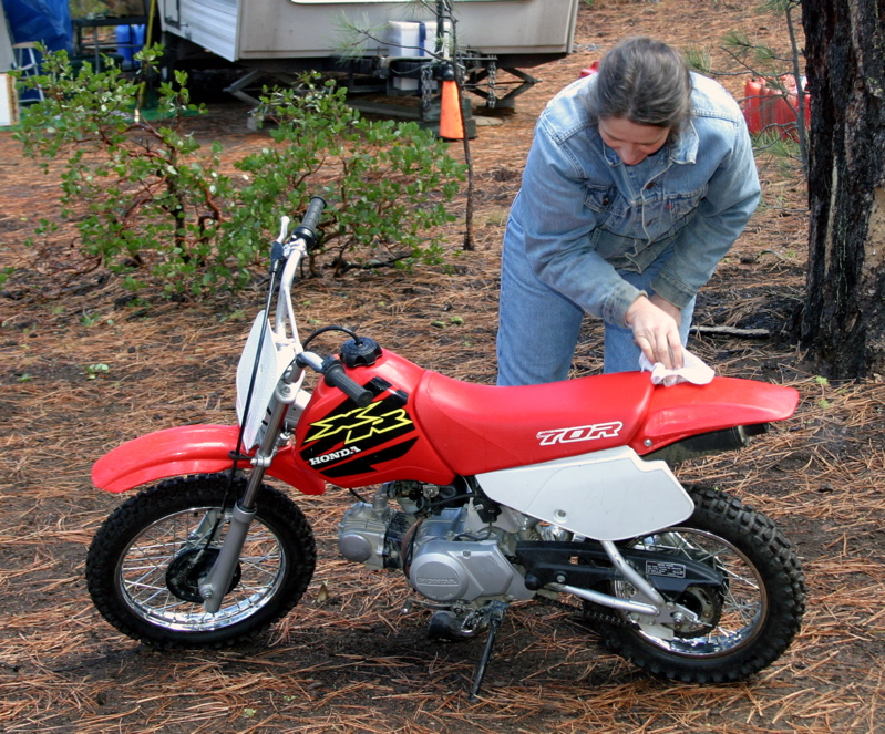 """<font size=""""+3"""">Colin's Mom, Karen Horn cleans off Colin's brand new motorcycle! </font>"""