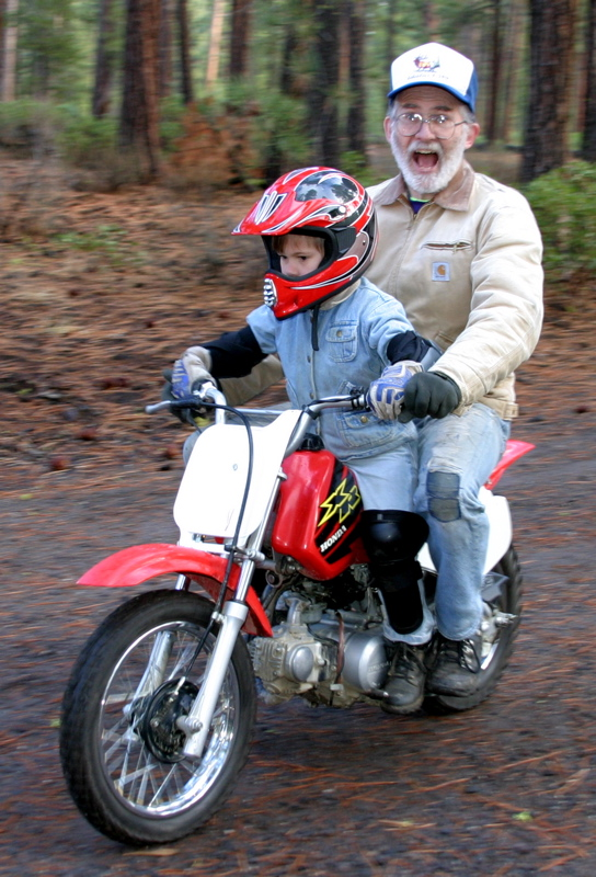 """<font size=""""+3"""">....and such a trusting father to let his kid ride him around, only the third time on a motorcycle in his life."""