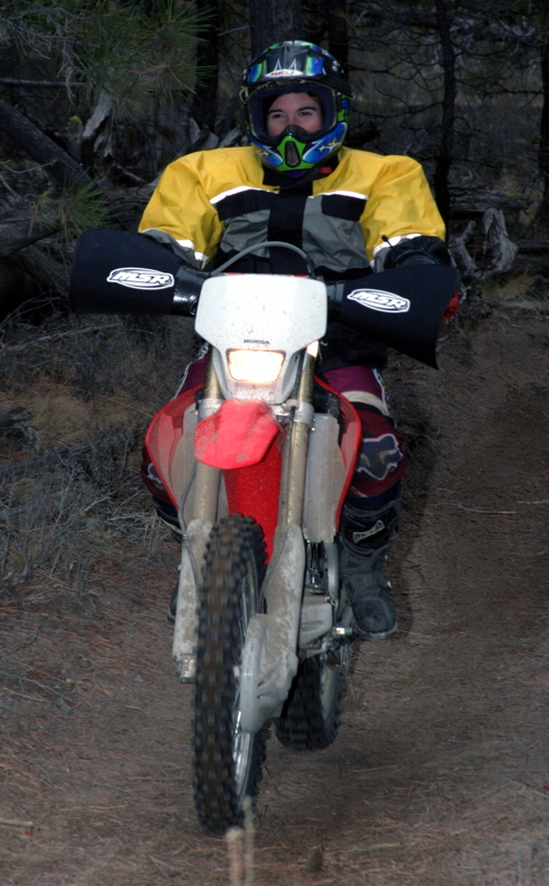 """<font size=""""+3"""">Here's Laura Stephenson on her new CR250F (have you noticed a LOT of these little CR's are showing up?) and here new riding jacket that makes her look like a pro quarterback.  She may look funny, but she said she never got cold, so I guess that's that part that matters most.."""