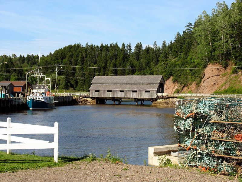 """St. Martins is a village on the Bay of Fundy in southern New Brunswick, Canada, 40 kilometres east of Saint John. As of 2001 the population was 374.<br /> <br /> The village was founded by Loyalists in 1783, and was originally known as Quaco. Through the 19th century, St. Martins was an important shipbuilding centre.<br /> <br /> St. Martins was incorporated in 1967. The village uses its scenery and two covered bridges to attract tourists. It also forms the start of the Fundy Trail, a 10 kilometre auto route along the rugged Fundy coast ending at Big Salmon River, a fomer lumbering centre. <a href=""""http://www.advrider.com/forums/showthread.php?t=217444"""">http://www.advrider.com/forums/showthread.php?t=217444</a>"""