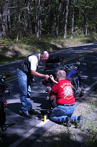 Mike and Bill get ready to plug the tire for the first time of the day.  We had been on the road for approximately 3 hours.