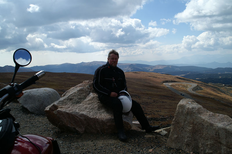 Atop the Beartooth Pass. A little dark in the exposure but my wind swept mug is so much more appealing that way.