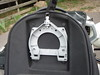 This shows the underside of the tank bag and the mount that fits the horse shoe ring on the tank.