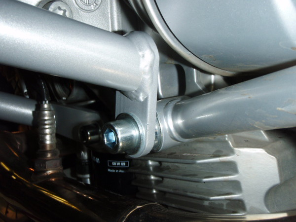 Lower bars rearward mount. Uses large spacer in the rear subframe mounting point.