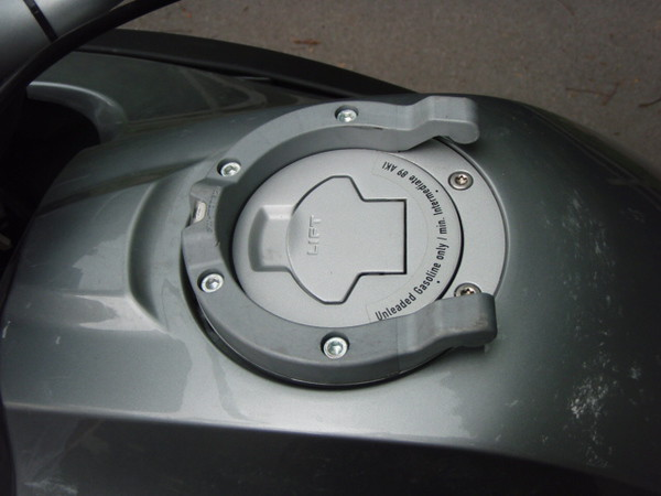 "This is the ""horse shoe ring"" that mounts to the tank filler ring, and accepts the tank bag. It will also accept some other accessories like a camera mount. See TwistedThrottle.com for more info."