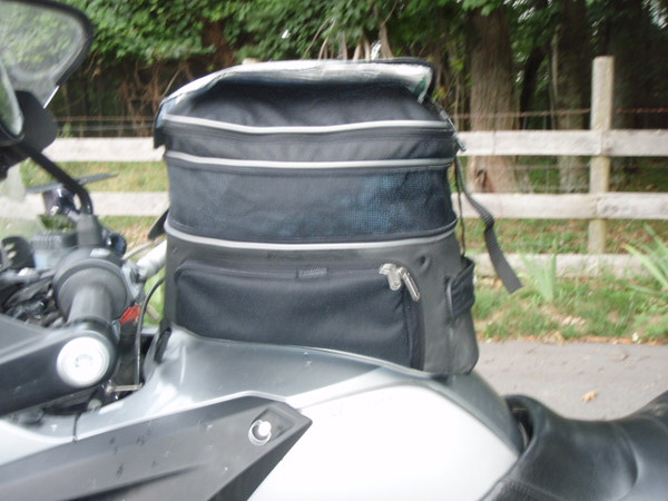 Tank bag closed with the two jugs of milk inside.