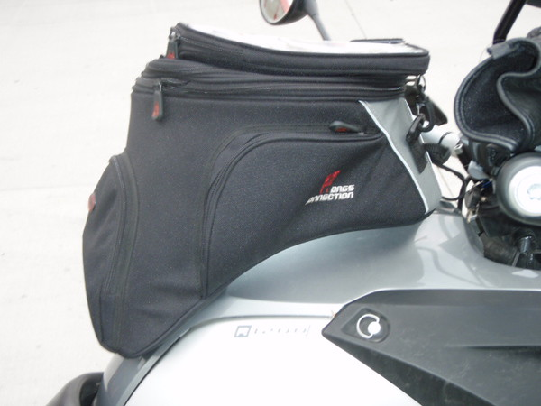 X-tra large GS Tankbag by Bags Connection, and sold by TwistedThrottle.com. Very nice roomy bag, with a very secure clamping mechanism that attaches a mount to the gas tank ring, then the tank bag clips into the mount. Easy to un hook for filling.