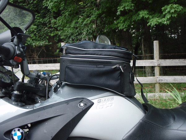 Wunderlick Tank Bag, its LARGE, and expandable. I replaced this with the Bags Connection tank bag from Twisted Throttle. I like this bag, it is very roomy. Attachment with straps around steering head, and under seat. It has a very large map case.