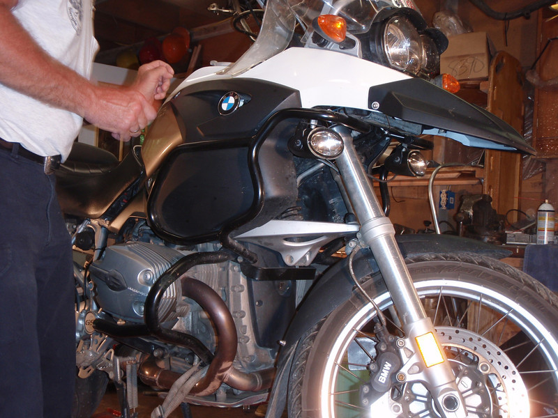 Gotta remove the tank panels, move the tank back a couple inches, loosen the crash bars.