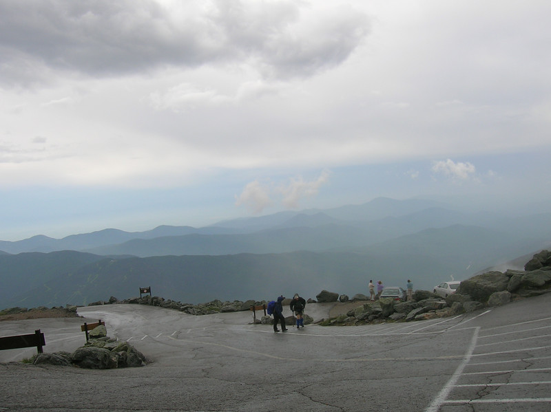 A glimpse of the surrounding mountains during a break in the clouds