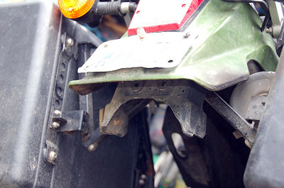 A self-606 induced trim job on John's rear fender.