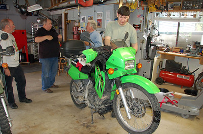 Slade busy working on his new fork springs, trying to ignore the bench racing behind him.