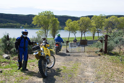 Tim waiting to lock the gate as we pass through.  The north tip of Jamison lake is in the background.