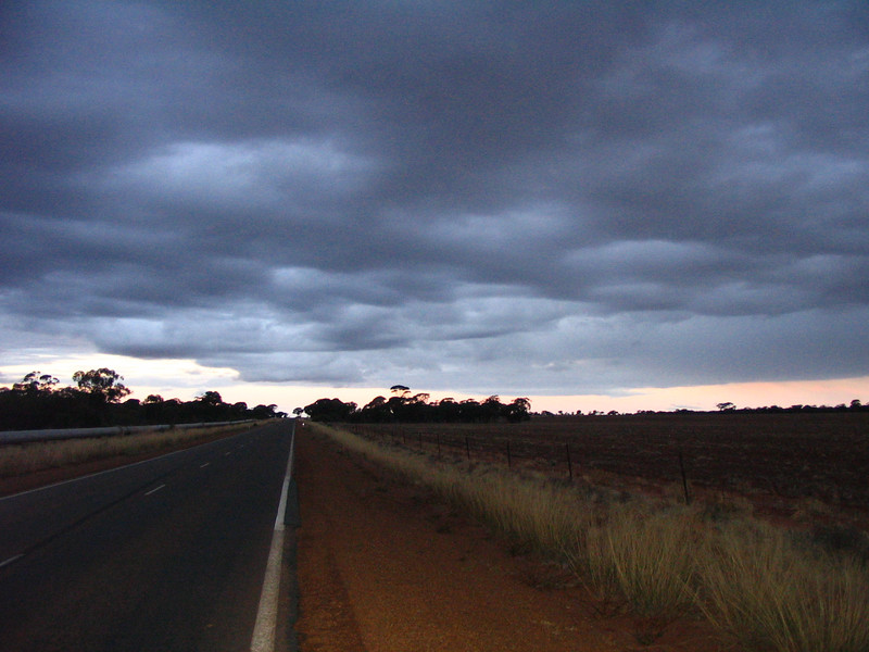 Taken the main hwy from Coolgardie (toward Perth) heading for Hyden and Wave Rock tomorow.  Sunset and approaching storm as I am trying to get to the town of Southern Cross before sunset. I arrive in SC with howling wind and hard rain looking for the SC motel.