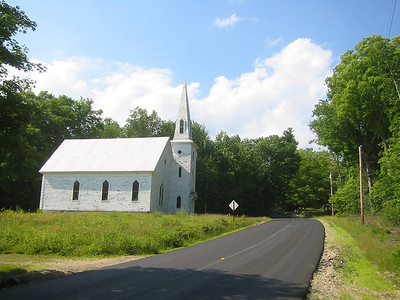 I have this same shot from about 15 years ago.  Nice to see the road paved...but the church needs some paint.