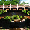 """Michigan's Eagle River Timber Bridge<br /> <br /> <a href=""""http://www.michiganhighways.org/indepth/M-26_timberbridge.html"""">http://www.michiganhighways.org/indepth/M-26_timberbridge.html</a><br /> <br /> glue-laminated timber bridge which carries M 26 over the Eagle River. Aesthetically, the new bridge blends in well with the scenic Copper Country, and structurally it was designed to carry the same traffic loads as our State trunkline concrete and steel bridges.<br /> <br /> The total length of the wooden bridge is just over 152 ft, and it stands 50 ft above the Eagle River. Supported by two, side-by-side arches spanning 74 and 79 ft, the bridge is primarily made of timber, with the connecting components fabricated of steel. <br /> <br /> Each of the two arches supporting the structure is actually made of two arched segments, joined at the top with a crown hinge, and measure 60 in. deep and 14 in. wide. The largest of the four segments is 42 ft from end-to-end, with a crown height of 25 ft, and weighs about 10,600 lb. The other three segments are 37 ft long, 18 ft to the crown, and weigh about 8,700 lb each. The base hinges that attach the arches to the concrete abutments and the two crown hinges, pivot on 4-in. diameter steel pins which are chrome plated to provide corrosion protection and lower friction resistance to any rotational movement of the arches."""