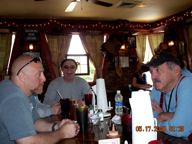 Rob, Gene and John exchange pleasantries.