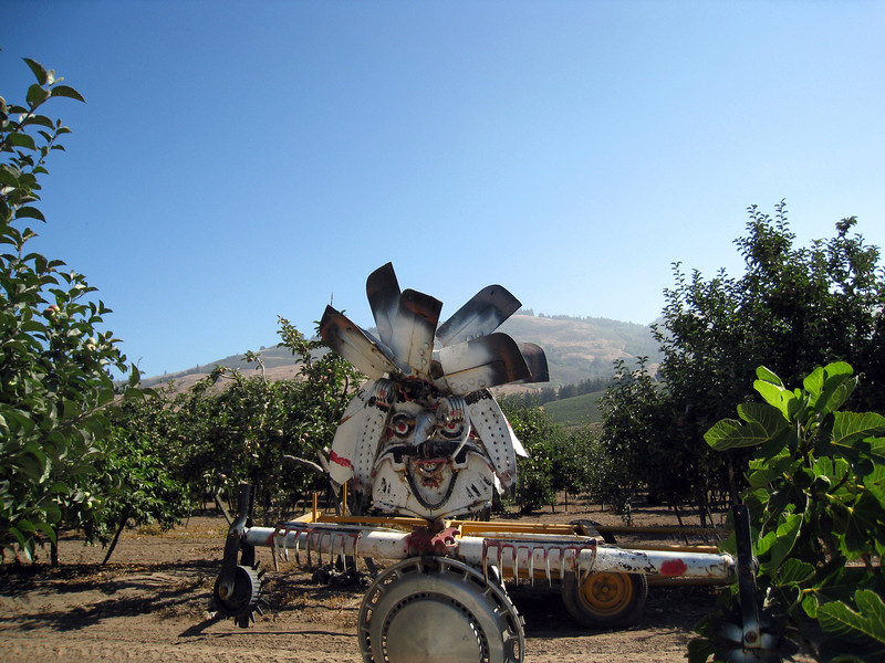 """this appears to be a """"scarecrow"""" made out of car parts, and random stuff from around the farm."""