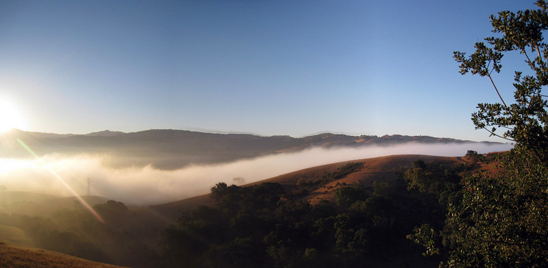early morning ride along calaveras road, san jose, ca. i really like the way the morning fog is hugging the valley.<br /> <br /> two photo panoramic stitched w/ autostitch