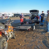 The pits/camp in  the morning.  It was pretty cold; note the frost on the ground.  Left to right is Mike, Dan and Mike's friend from Moses Lake Andrew.