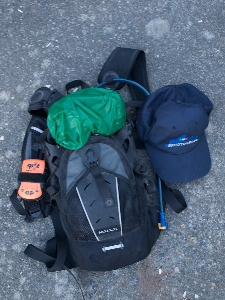 Camelbak M.U.L.E. hydration pack with 100 oz of water, first aid kit, a couple energy bars, fire starter, goggles, and hat. Spot Messenger velcroed to the shoulder strap. H/t Greg Hilchey for that one.