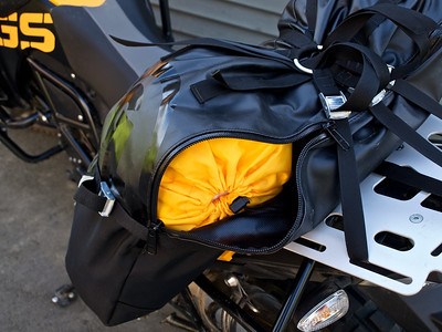 Access to some stuff in the bag is somewhat hampered by the straps, but properly stowed you could put stuff you need on the road in this section.