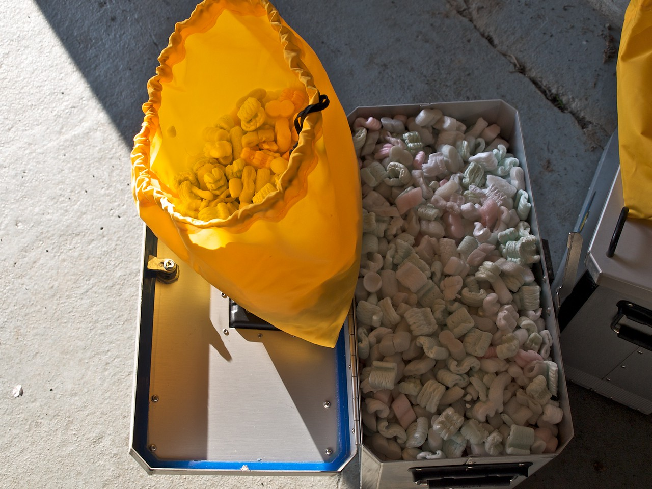 One of my 38-litre Metal Mule panniers filled with the packing peanuts that had been in the Great Basin, along with another maybe 8-litres still in the yellow bag, plus the (2) 2-litre bottle holders gives about a 50-litre capacity--just like Giant Loop says.