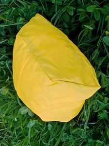 The waterproof yellow stuff sacks are shaped to fit the space, and (obviously) removable.