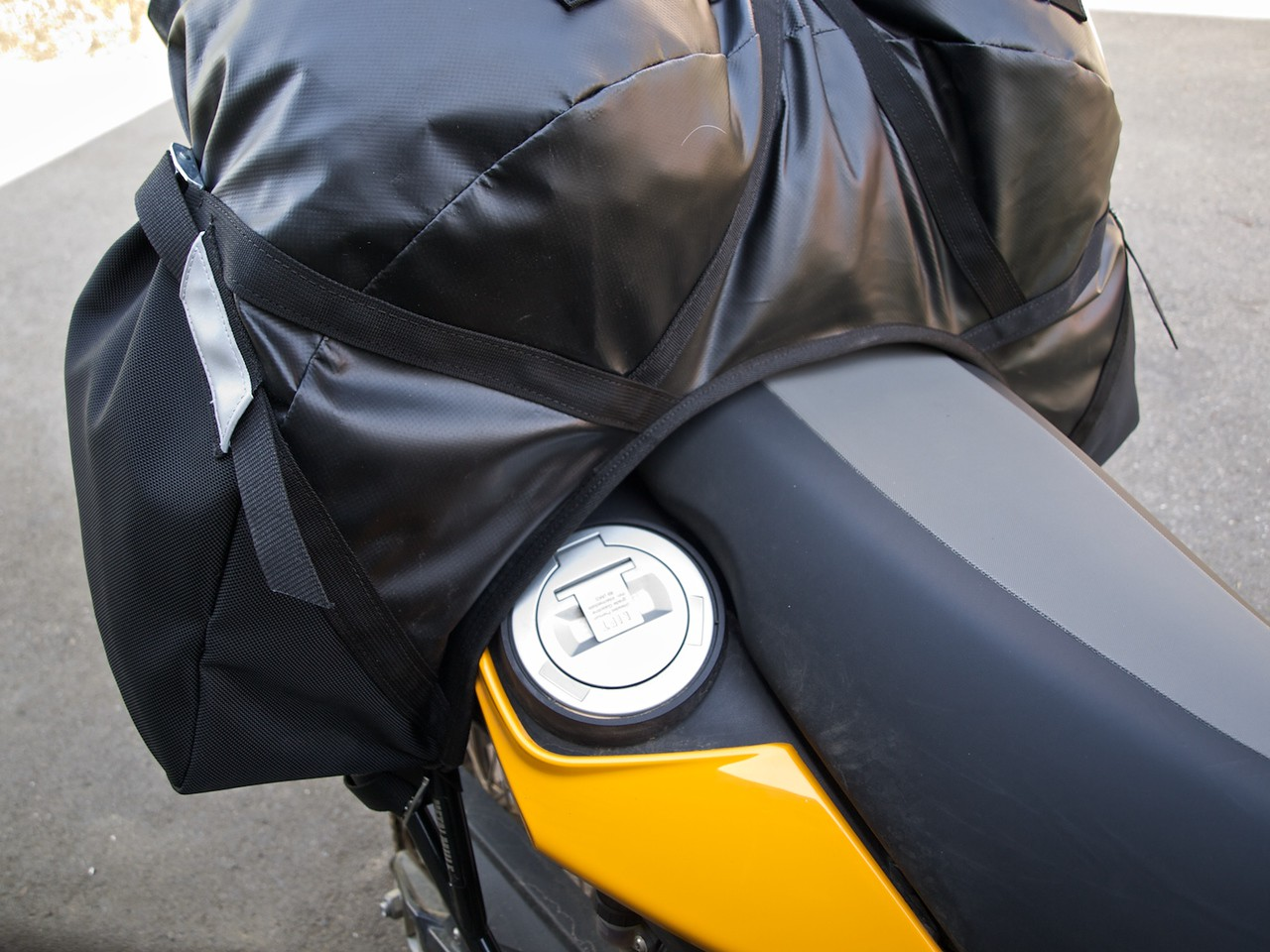 Closer view of the gas cap access. The right strap loosens in about one second. Not an issue.