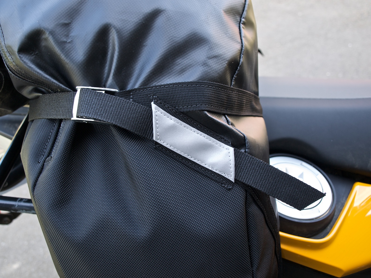 A slot behind the reflective patch to capture the tail of the strap. Nice touch.