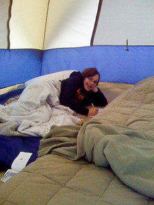 Natalie liked relaxing and writing in the tent.
