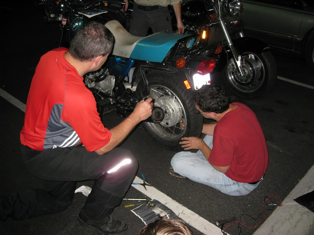 "Jack's old Beemer had what's referred to in riding moniker as ""a mechanical"" - the rear brakes kept dragging.  When he took the wheel off, the entire drum brake assembly fell out in pieces.  One spring scavenged from the side stand, and problem solved!"