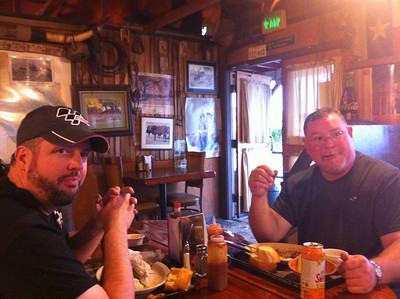 Dave Taylor and Bob Rasters eating their fill of meat.