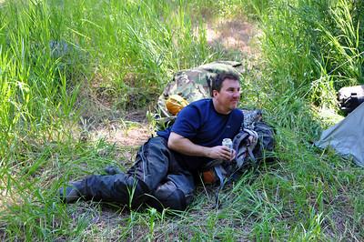 Male model Dan resting after arriving at camp.