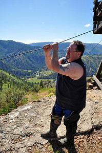 Rob prepares to slide down the cable bare handed.  Tough guy.