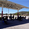 the group takes refuge in the only shade for miles; an abandoned gas station that had seen better days.