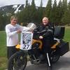 Bob Torter holding his 2009 Not Superman Rally flag