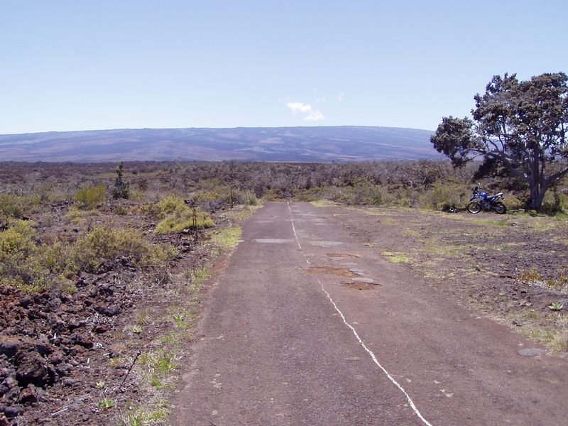 Mauna Loa Road, leads up to the weather observatory at 11,000 feet.  The centerline gives the inpression that someone punched a hole in a can and sat on the tailgate of a truck and dumped the paint, Yep that's how they did it.